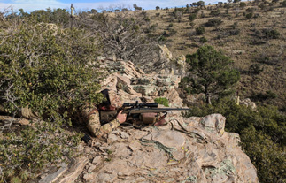 Coues deer hunt shot from rock ledge